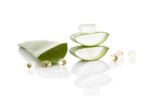 Aloe vera gel caps. Aloe vera sliced leaf and aloe vera gel caps isolated on white background.